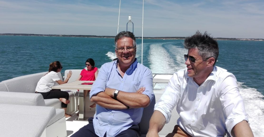 Oliver Frols and Erik Stromberg enjoying on board the new prestige 590 yacht